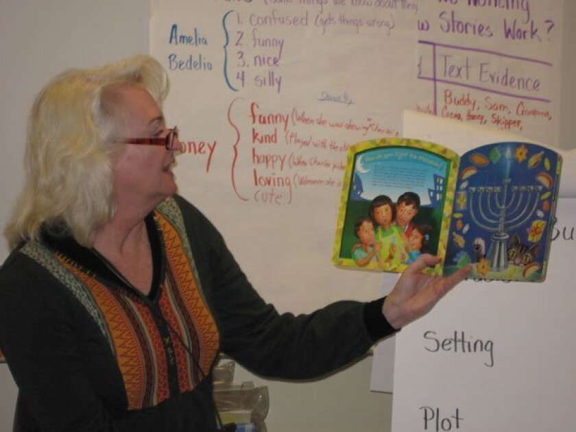 Teacher Laurie White reads the story of Hanukkah to her second-grade class. Photo: Lorri Sabban