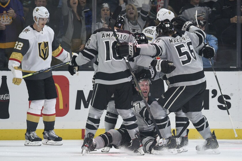 Kings players celebrate with teammate Jeff Carter, bottom, after his third-period goal.
