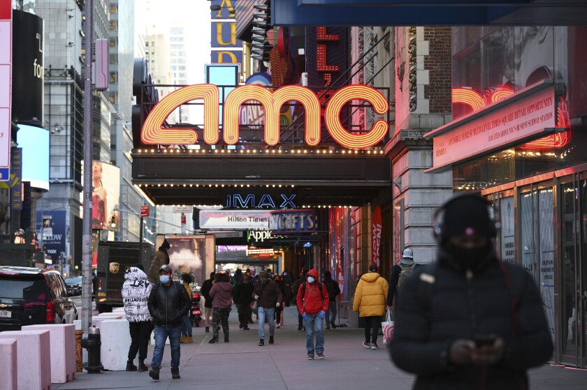 An AMC movie theater is seen on a street in New York.
