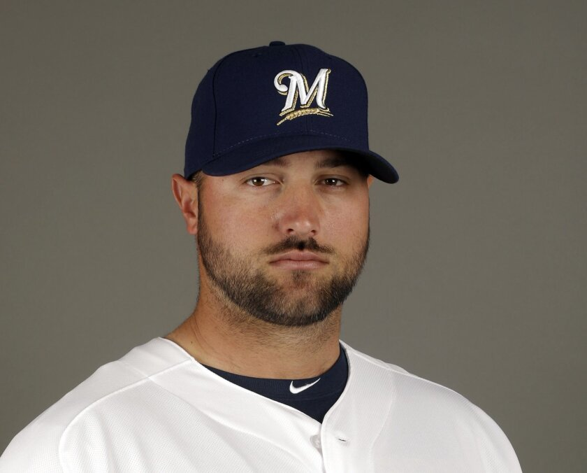 FILE - This 2015, file photo shows Milwaukee Brewers' Jonathan Broxton. The St. Louis Cardinals have acquired reliever Jonathan Broxton from the Milwaukee Brewers, supplementing their bullpen with another veteran. The NL Central-leading Cardinals sent minor league outfielder Malik Collymore to their division rivals. St. Louis also received an unspecified amount of cash in the deal announced hours before the trade deadline on Friday afternoon, July 31, 2015. (AP Photo/Morry Gash, File)