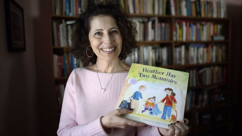 """Leslea Newman with her children's book """"Heather Has Two Mommies."""""""