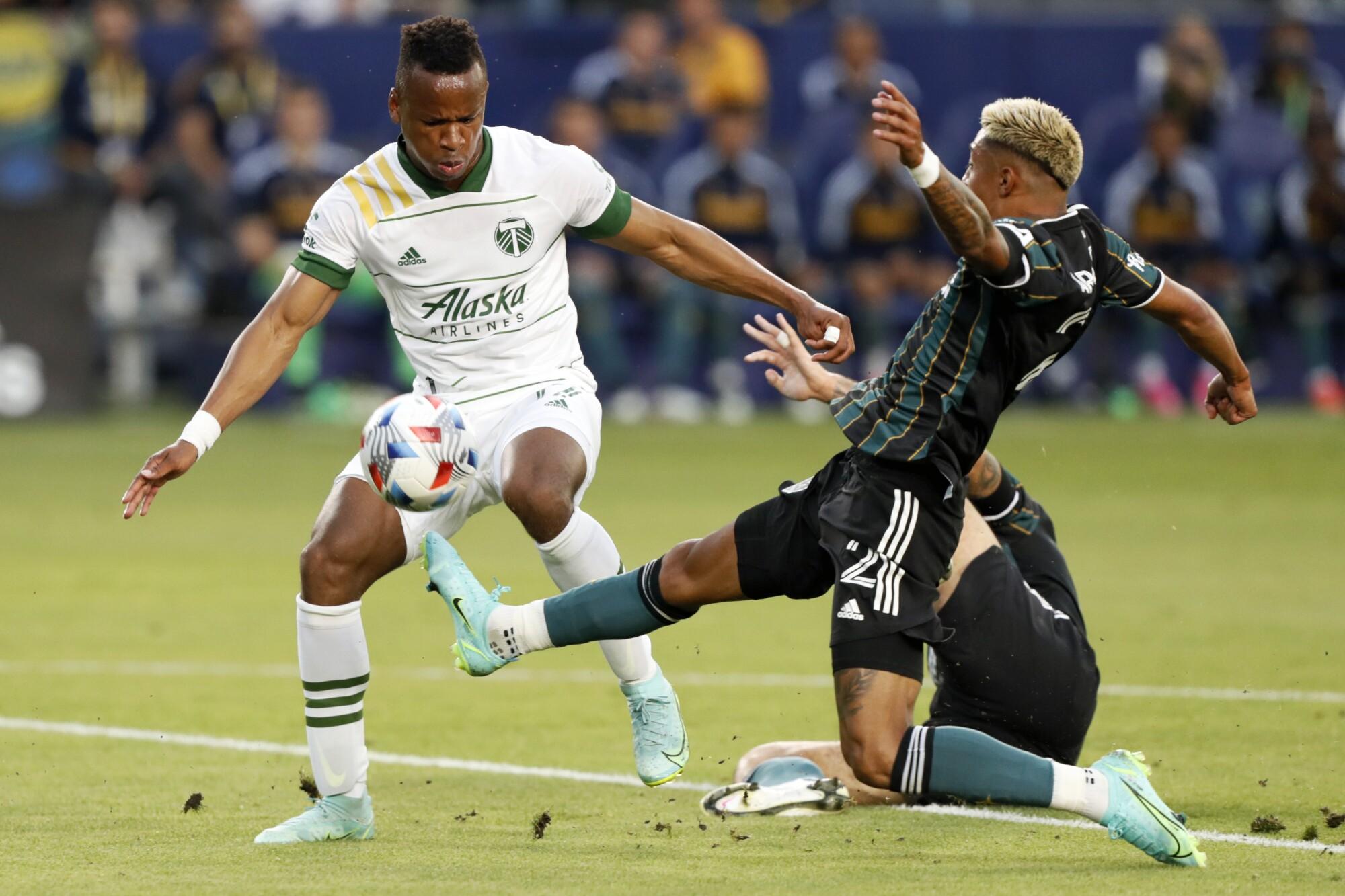 Galaxy defender Julian Araujo works against Portland Timbers forward Jeremy Ebobisse