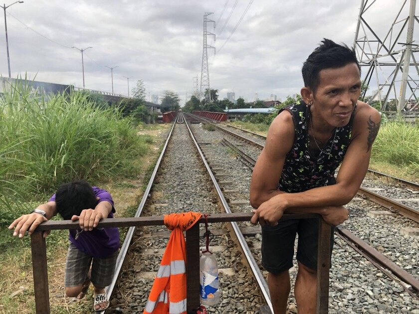 """Alfred """"Betong"""" Mendez runs a trolley in Manila. For about 40 cents, anyone can climb onto his makes"""