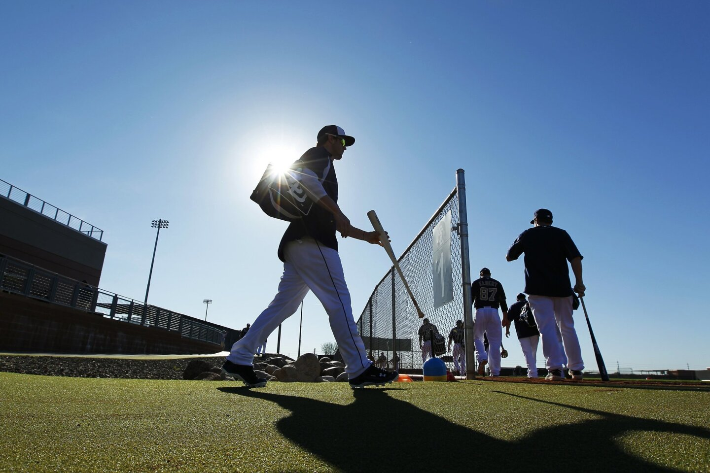 Padres players take the field for a spring training practice.