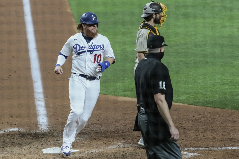 Dodgers third baseman Justin Turner scores in the fifth inning in Game 1 of the NLDS at Globe Life Field.