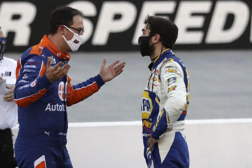 Drivers Joey Logano, left, and Chase Elliott talk following a NASCAR Cup Series auto race at Bristol Motor Speedway Sunday, May 31, 2020, in Bristol, Tenn. (AP Photo/Mark Humphrey)