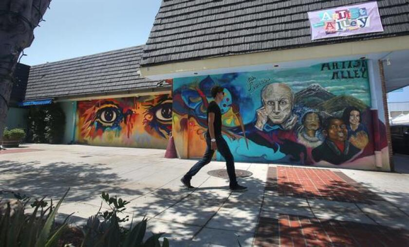 One of the city's newest murals, called Ojos de Picasso, left, by San Diego muralist Mario Torero, is in Artist Alley across the street from city hall behind the Breakfast Club Diner in Oceanside.