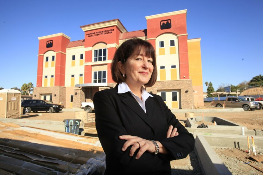 Fran Butler-Cohen, chief executive of Family Health Centers of San Diego, stands in front of a soon-to-be-completed health center at 47th and Market streets.
