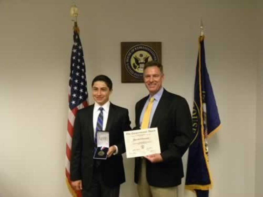 Jacob Chasan is presented with the Congressional Award by Congressmember Scott Peters on July 26. Courtesy