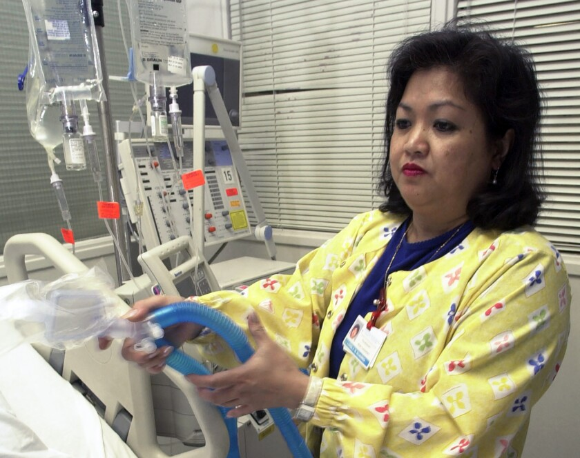 A respiratory therapist at Newark Beth Israel Medical Center in New Jersey sets up a ventilator in the intensive care unit. Hospitals bracing for coronavirus patients may face a critical shortage of equipment.