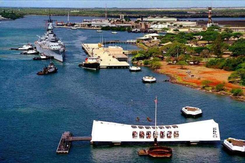 In this 1998 photo, the USS Missouri is towed into Pearl Harbor. It is now moored bow to bow with the submerged USS Arizona.
