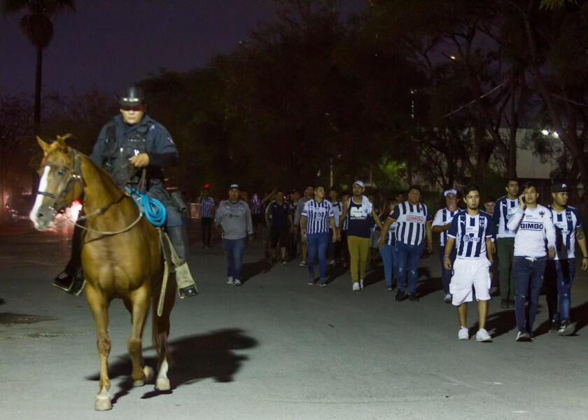State Police guard Monterrey's fans outside the University stadium as they look for the responsible of attacking a Tigres' fan in Monterrey, Mexico, on September 23, 2018.