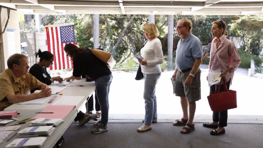 Voters line up in a garage to vote in California.