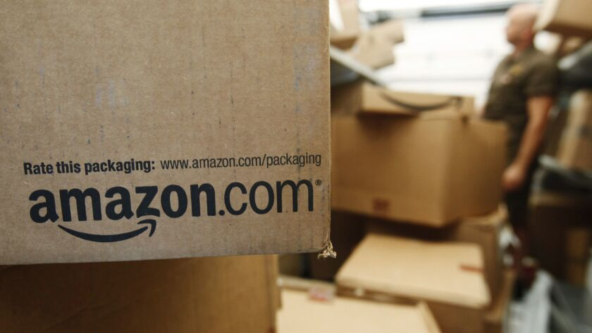 FILE - In this Oct. 18, 2010, file photo, an Amazon.com package awaits delivery from UPS in Palo Alt