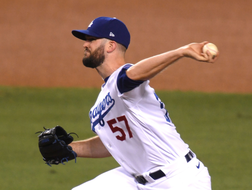 Alex Wood pitches in relief against the Arizona Diamondbacks on Tuesday