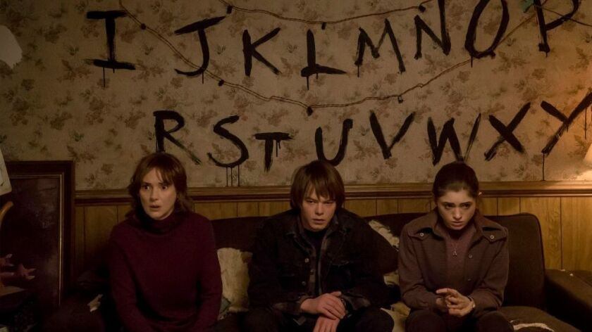 """Winona Ryder, Charlie Heaton and Natalia Dyer in the Netflix show """"Stranger Things."""""""