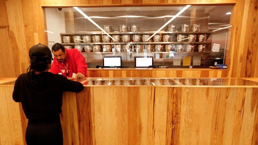 WEST HOLLYWOOD, CA - JANUARY 5, 2016 -- Lead bud tender Emanuel Garcia fills a customer's order a