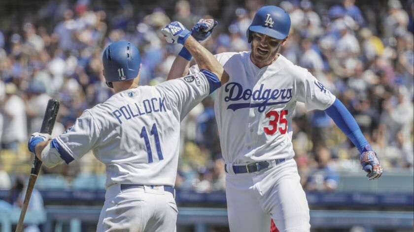 LOS ANGELES, CA, SUNDAY, MARCH 31, 2019 - Cody Bellinger celebrates with Dodgers teammate AJ Pollock