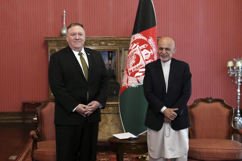 Secretary of State Michael R. Pompeo meets with Afghan President Ashraf Ghani at the presidential palace in Kabul on March 23, 2020. Pompeo sought to rescue a U.S.-Taliban agreement deal but failed to make apparent progress.
