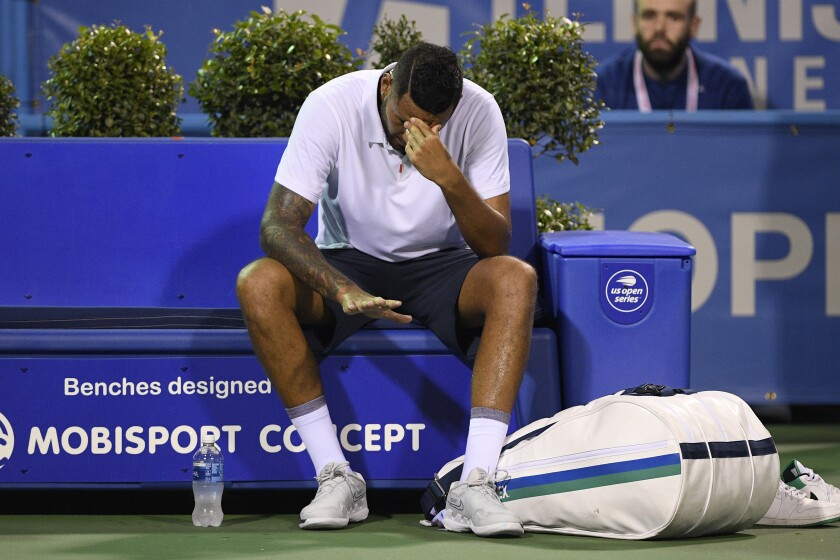 Nick Kyrgios, of Australia, reacts after losing to Mackenzie McDonald, of the United States, at the Citi Open tennis tournament, Tuesday, Aug. 3, 2021, in Washington. McDonald won 6-4, 6-4. (AP Photo/Nick Wass)
