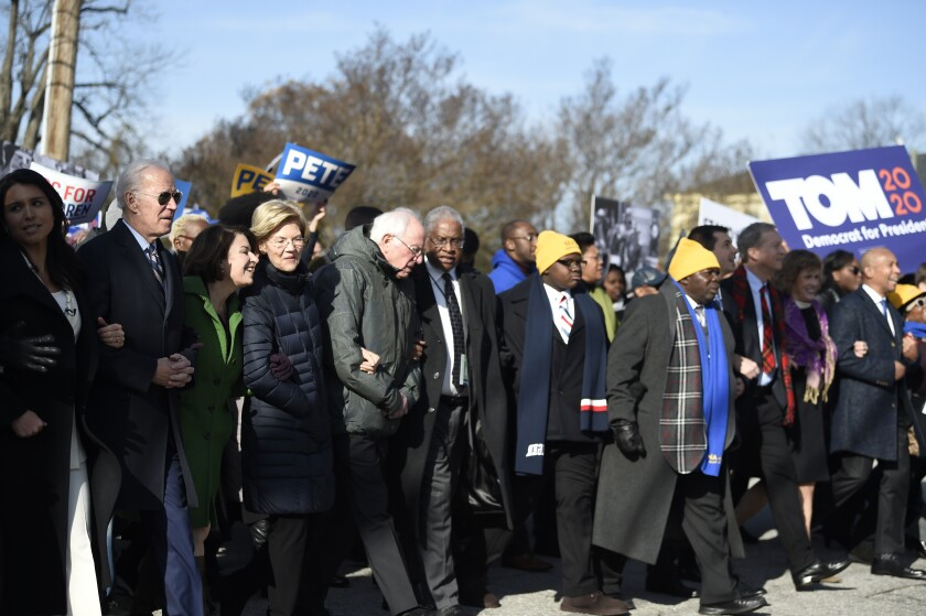 Most of the Democrats seeking their party's presidential nomination march in a Martin Luther King Jr. Day rally on Monday, Jan. 20, 2020, in Columbia, S.C.