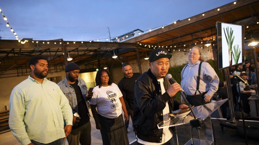 Chef Roy Choi of Locol is presented with the Restaurant of the Year award by critic Jonathan Gold du