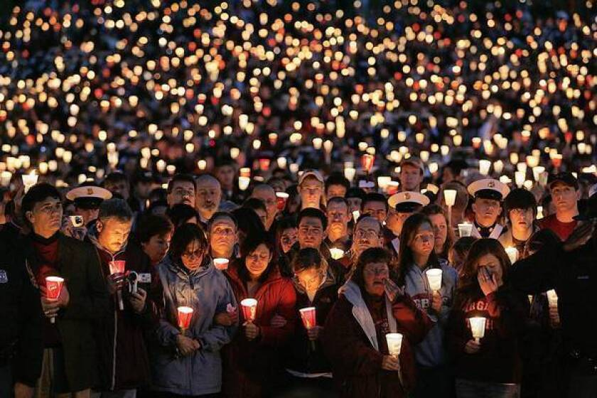 Thousands at a vigil mourn shooting victims at Virginia Tech in 2007. The massacre prompted federal legislation to improve a database to keep guns out of the hands of the mentally ill, but results are mixed and many states don't take part.