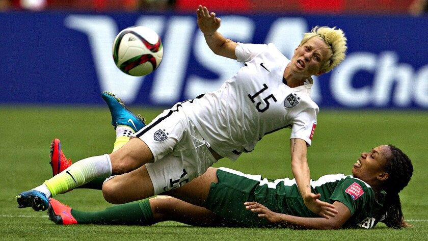 U.S. midfielder Megan Rapinoe, here being brought down by a tackle at last year's World Cup, will play in the Olympics after overcoming a major knee injury.