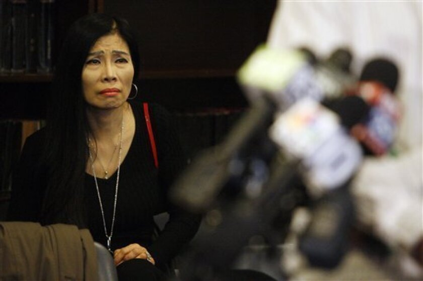 Mabel Chan looks on during a news conference where Chinese students spoke about rising tension at South Philadelphia High School, Friday, Dec. 4, 2009, in Philadelphia. Tension between black and Asian students at the Philadelphia high school erupted in a series of assaults that led some teens to seek hospital treatment and district officials to suspend 10 students and increase police presence at the school.(AP Photo/Matt Slocum)