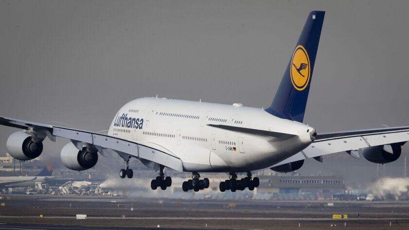 An Airbus A 380 of Lufthansa airline lands the airport in Frankfurt, Germany, Thursday, Feb. 14, 201