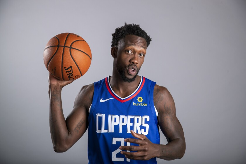 Clippers guard Patrick Beverley poses for photos during media day.