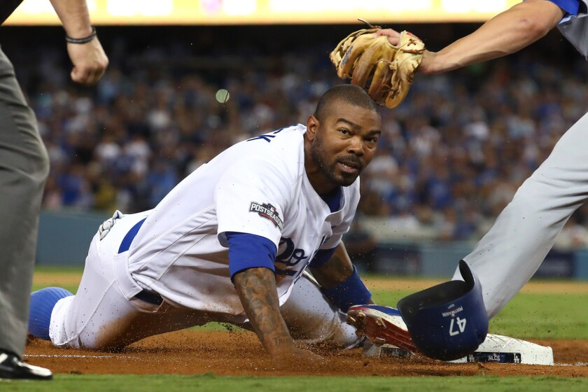 The Dodgers' Howie Kendrick steals third base in the fourth inning against the Chicago Cubs in Game 5 of the NLCS at Dodger Stadium on Oct. 20.