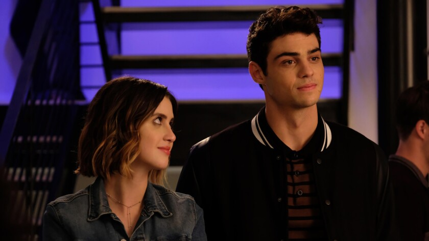 "(L-R)- Laura Marano and Noah Centineo in a scene from ""The Perfect Date."" Credit: Netflix"