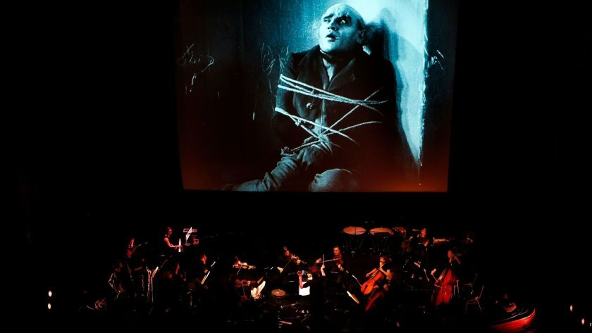 """Members of the L.A. Opera Orchestra rehearse for the Saturday presentation of """"Nosferatu"""" at the Theatre at Ace Hotel in Los Angeles. The program repeats on Halloween."""