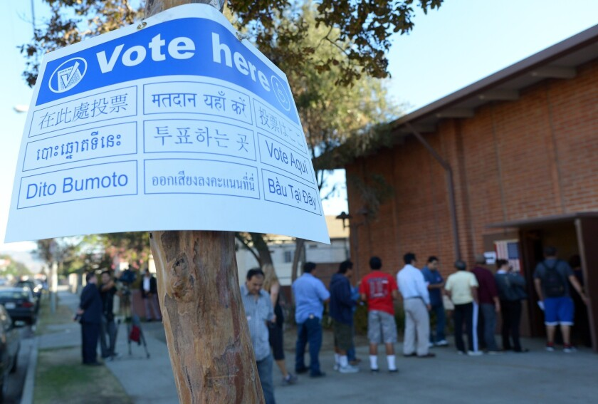 Sun Valley residents wait in line to vote at the polling station located at Our Lady of The Holy Church on election day at the Sun Valley's Latino district, Los Angeles County, on Nov. 6, 2012 in California.