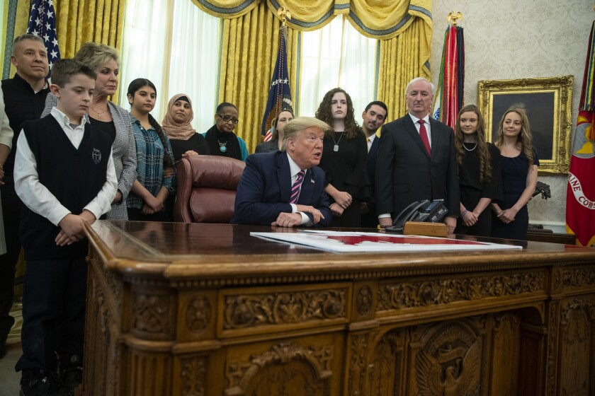 President Trump speaks during an event promoting religion in schools in the Oval Office on Thursday.