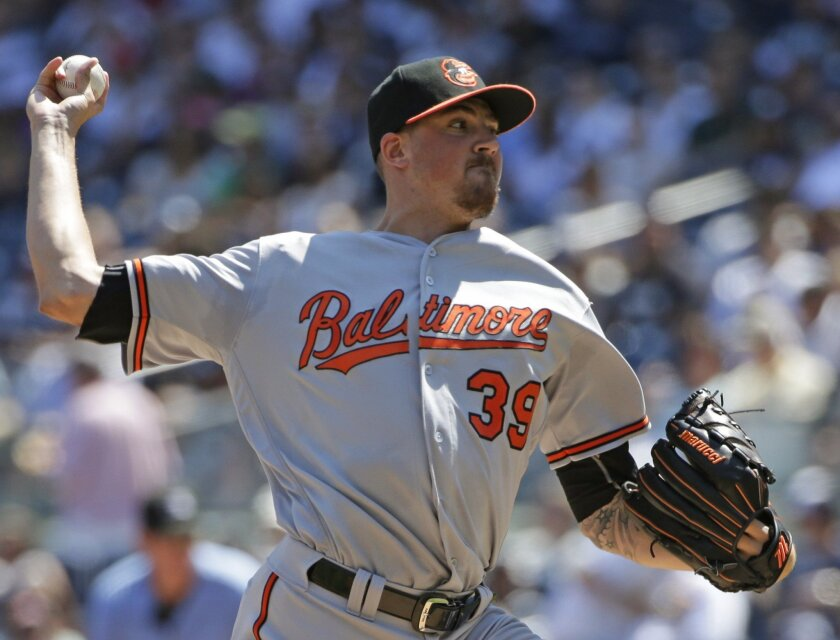 Baltimore Orioles starting pitcher Kevin Gausman (39) delivers during the first inning of a baseball game against the New York Yankees in New York, Sunday, Aug. 28, 2016. (AP Photo/Kathy Willens)