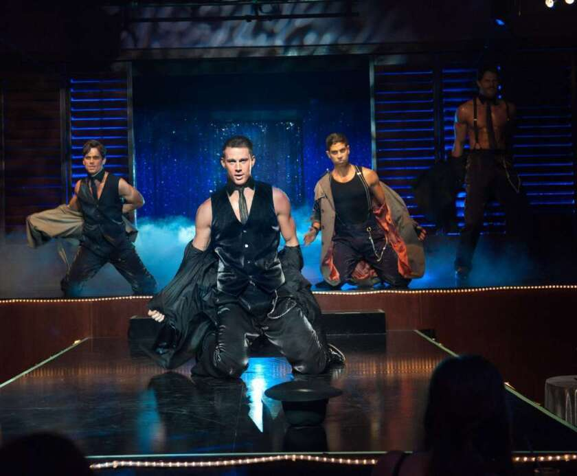 """Channing Tatum, center, in a scene from """"Magic Mike."""" The star confirmed that the film is Broadway bound though no word yet on whether he'll be starring."""