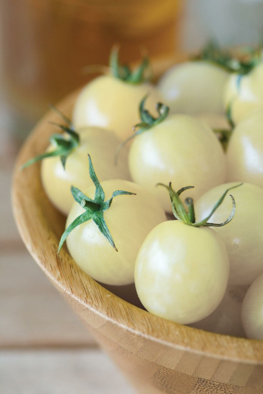 Italian Ice Tomatoes ripen to a buttery ivory color.