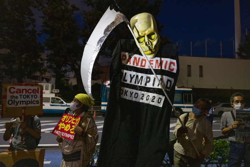 Protesters demonstrate near Olympic Stadium in Tokyo on Thursday.