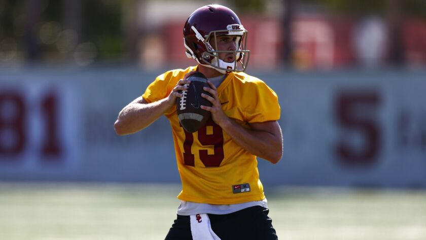 LOS ANGELES, CALIF. - AUGUST 03: USC Trojans quarterback Matt Fink (19) passes during drills as the