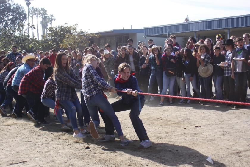 Eighth-graders participate in a tug-of-war at Muirlands Middle School's Western BBQ on Dec. 20, 2018.