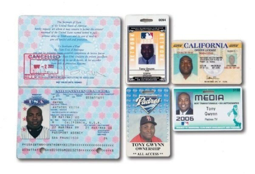 A grouping of five of Tony Gwynn media passes and IDs, including an old driver's license and a passport picturing him in his Padres uniform, sold at auction for $3,585.