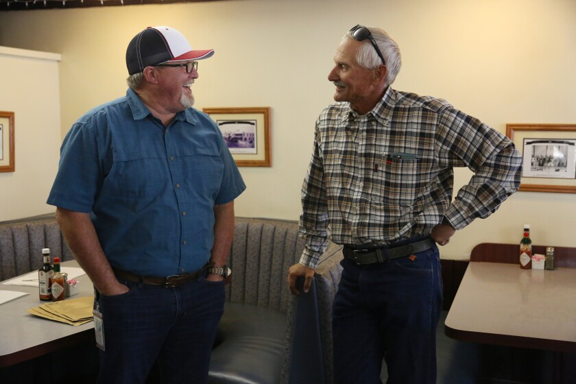 Mayor Dave Noerr, right, chats with Jeff Joseph, one of many Taft. Calif., residents who works in the oil industry.