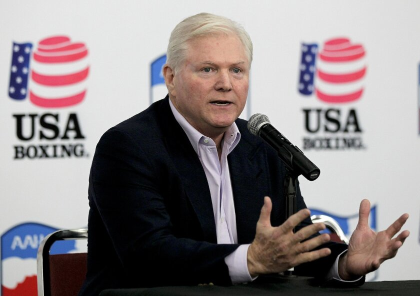 FILE - In this photo April 25, 2012 file photo, Michael King talks to the media during a news conference at a boxing gym in Carson, Calif. King, an innovative TV syndicator who with his brother helped make stars of Oprah Winfrey, Dr. Phil McGraw and Rachael Ray, has died. A family member confirms King, 67, died Wednesday, May 27, 2015, in Los Angeles of complications from pneumonia. (AP Photo/Chris Carlson, File)