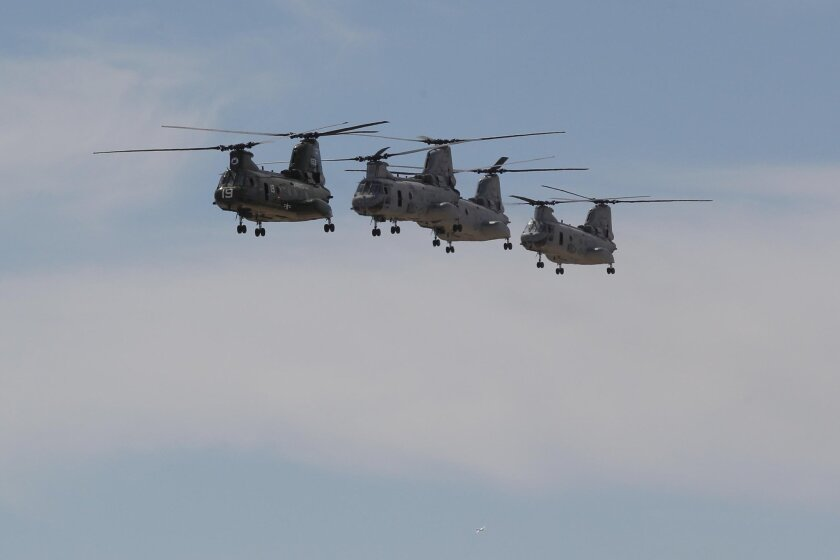 A CH-46 helicopter that entered the Marine fleet during the Vietnam War was given a historic paint job in glossy green. The 2014 Miramar Air Show is the last time the helicopter will perform before the airframe is retired from service, replaced by the MV-22 Osprey.