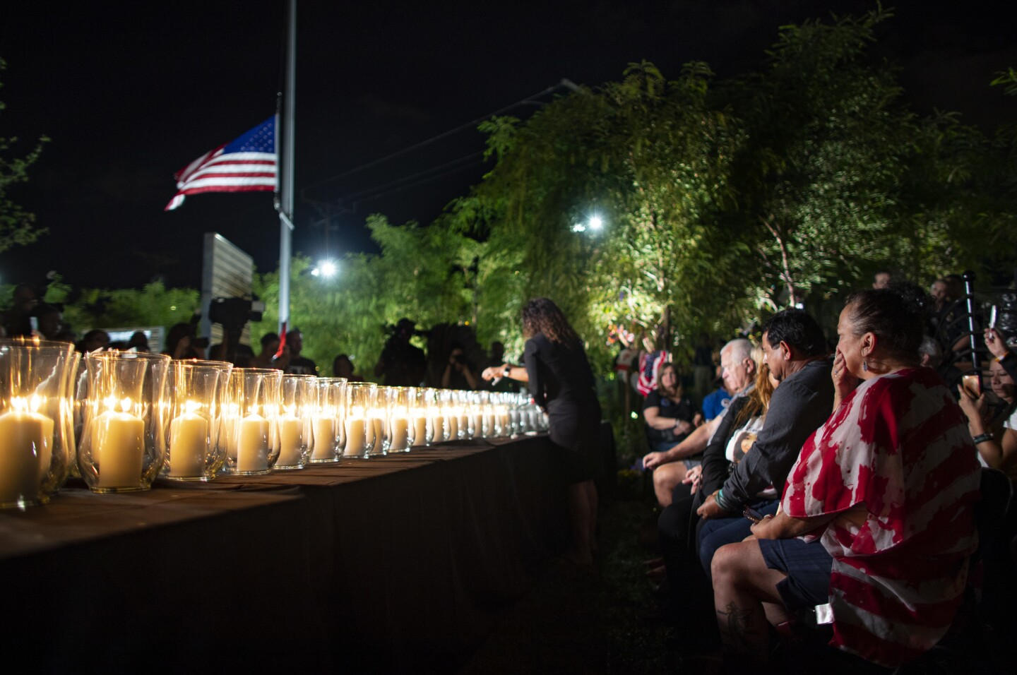 Family members grieve as the 58 victims' names are read aloud and candles are lit Oct. 1 on the one-year anniversary of the mass shooting in Las Vegas, Nevada.