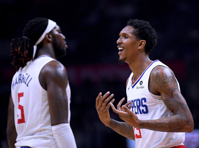 Clippers guard Lou Williams reacts to a foul call alongside teammate Montrezl Harrell during a game against the Hawks last season.