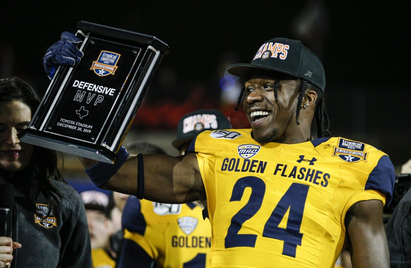 Kent State defensive back Qwuantrezz Knight (24) celebrates winning defensive MVP in the Frisco Bowl.