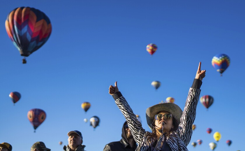 Laugh director Nicole Tagart gives a thumbs up to a pilot indicating they are good to take off at the 2021 Albuquerque International Balloon Fiesta Saturday, Oct. 2, 2021, in Albuquerque, N.M. (Roberto E. Rosales/The Albuquerque Journal via AP)